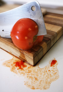 Tomato murder (on wood cutting board)