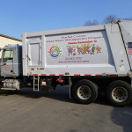 Trash and recycling truck. -- household waste management
