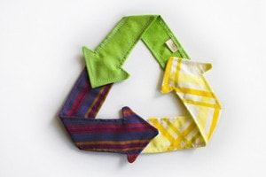 Textile recycling triangle. Recycle old fabric