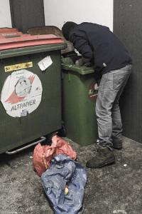 Dumpster diver rescuing food waste